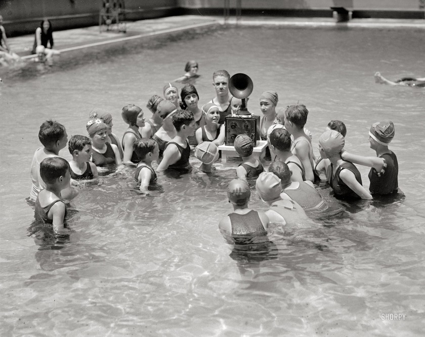 children-listening-to-radio-in-swimming-pool-ca-1920s